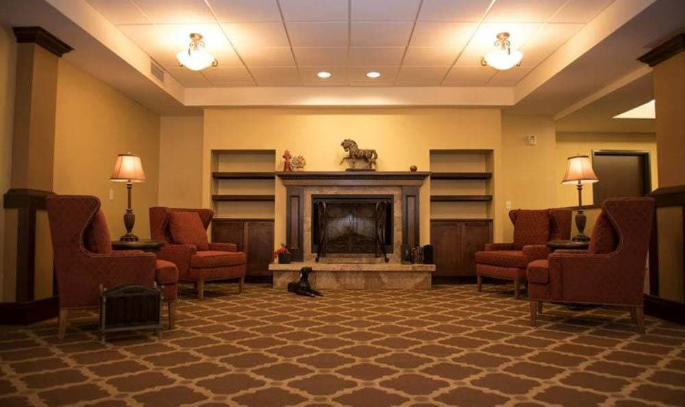 Large Fireplace and Sitting Area At Joshua Springs Senior Living.