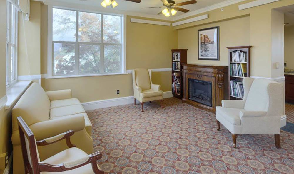 Resident seating area and fireplace at Queen Anne Manor Senior Living in Seattle.