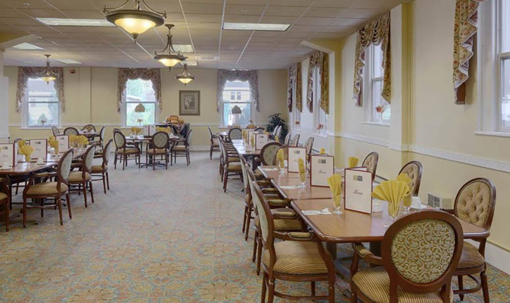 Large Community Dining Area At Queen Anne Manor Senior Living.