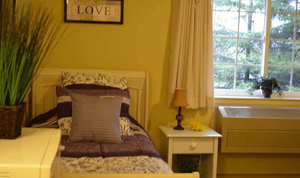 Cascade Valley Senior Living bedroom with outside view in Arlington