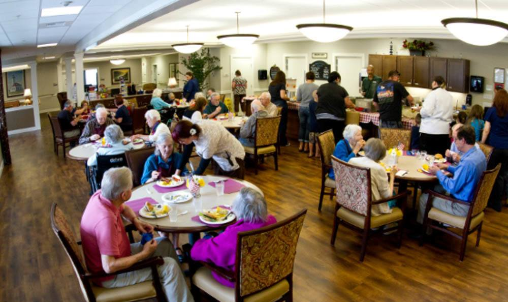 Residents in Dining Hall at Lighthouse Memory Care