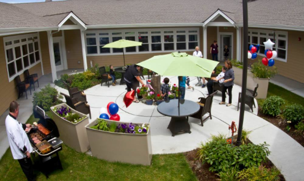 Outdoor Patio and Barbecue at Lighthouse Memory Care