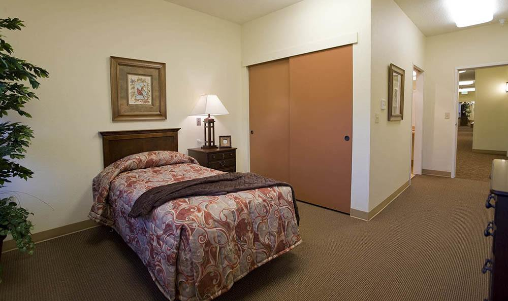 Bedroom at McLoughlin Place Senior Living in Oregon City.