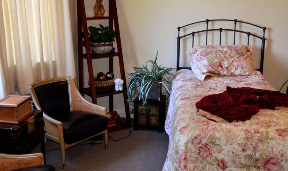 Serene bedroom at Windchime of Chico in Chico, California.