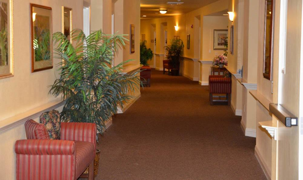 Wide hallways of upscale senior living facility at Windchime of Chico in Chico, California.