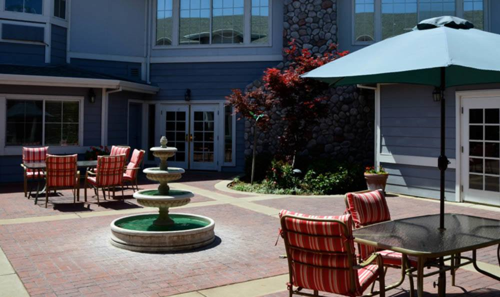 Sunny outside sitting area complete with fountain at  Windchime of Chico in Chico, California.