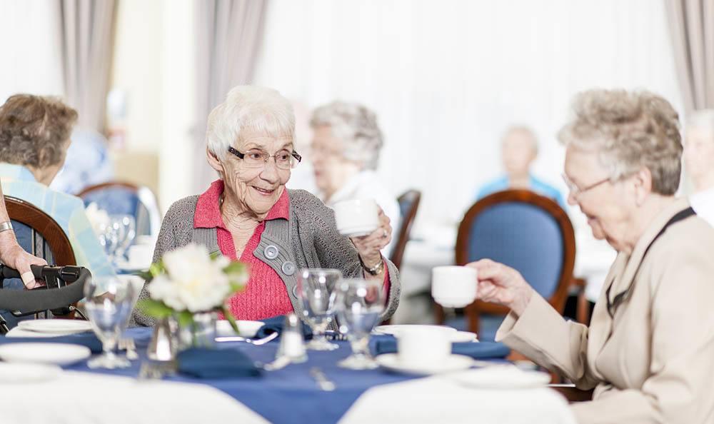 Residents Enjoying Tea at Logan Creek Retirement Community