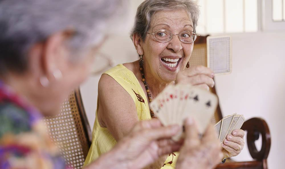 Residents playing cards At The Renaissance of Stillwater