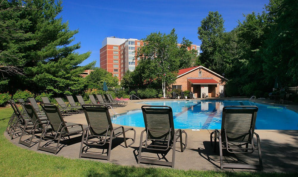 Plenty of lounge chairs so you can soak up the sun by the pool at Kimball Towers at Burlington.