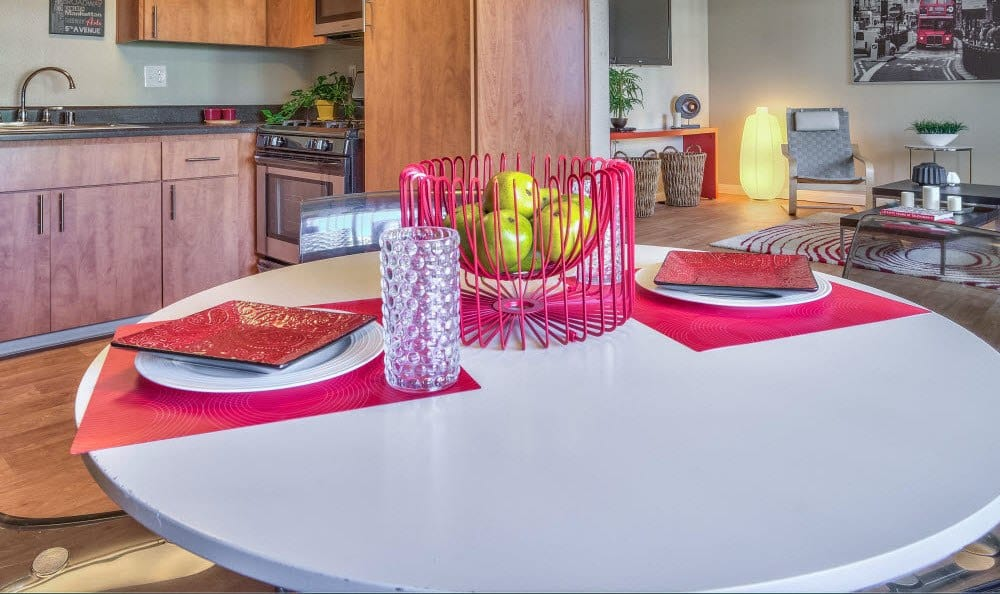 View the dining room table in this example apartment at Alvista Long Beach