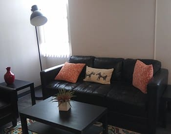 Comfortable living area at Congress Park Apartments in Denver.