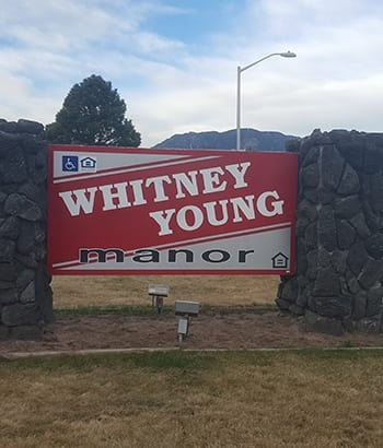 Welcome sign of Whitney Young Manor apartments in Colorado Springs