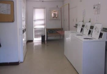 Laundry room at Meadow Run Apartments in Anderson