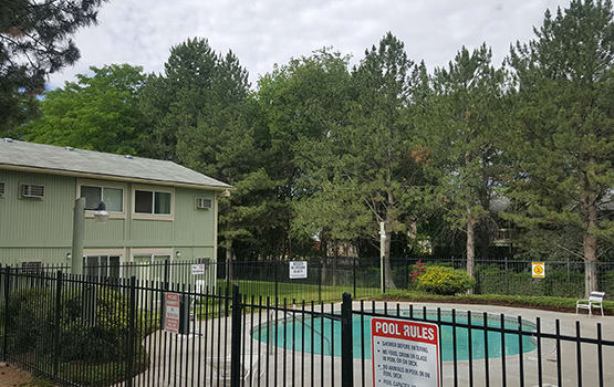 The swimming pool area at James Court is a popular spot to socialize with neighbors at our apartment community in Meridian.