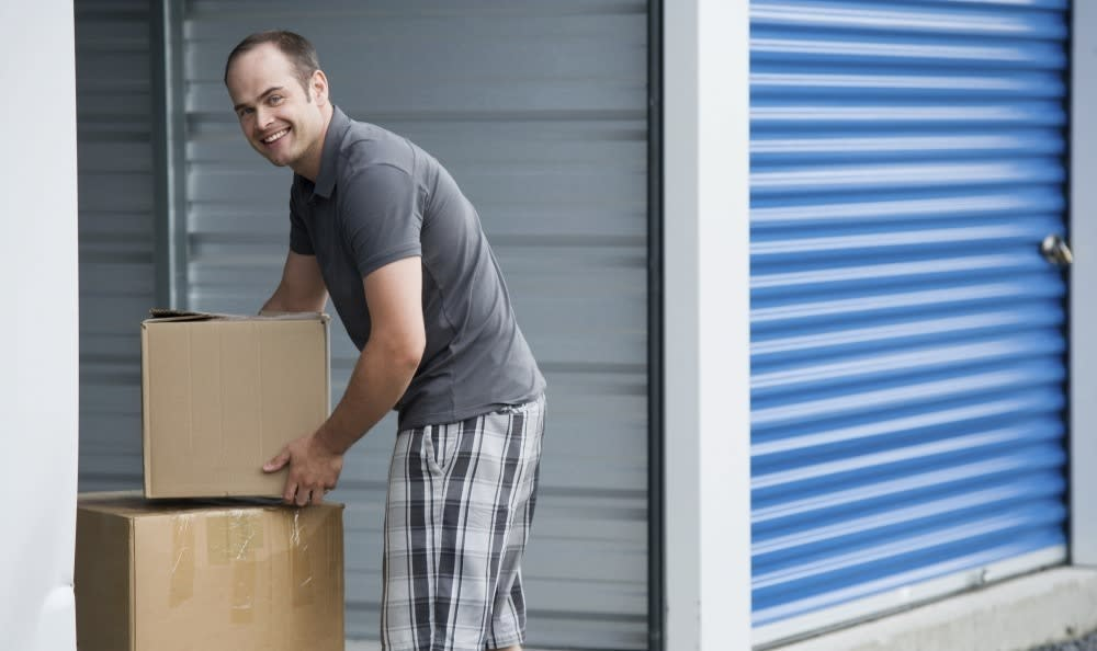 Man Storing Things At SurePoint Self Storage - FM 3009