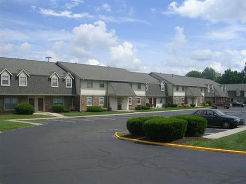 Parking lot of Apartments for rent at Covington Square Apartments and Townhomes in IN.