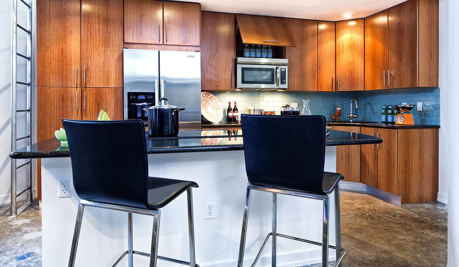 Open kitchen with concrete flooring at The Exchange Lofts in Fort Lauderdale, Florida