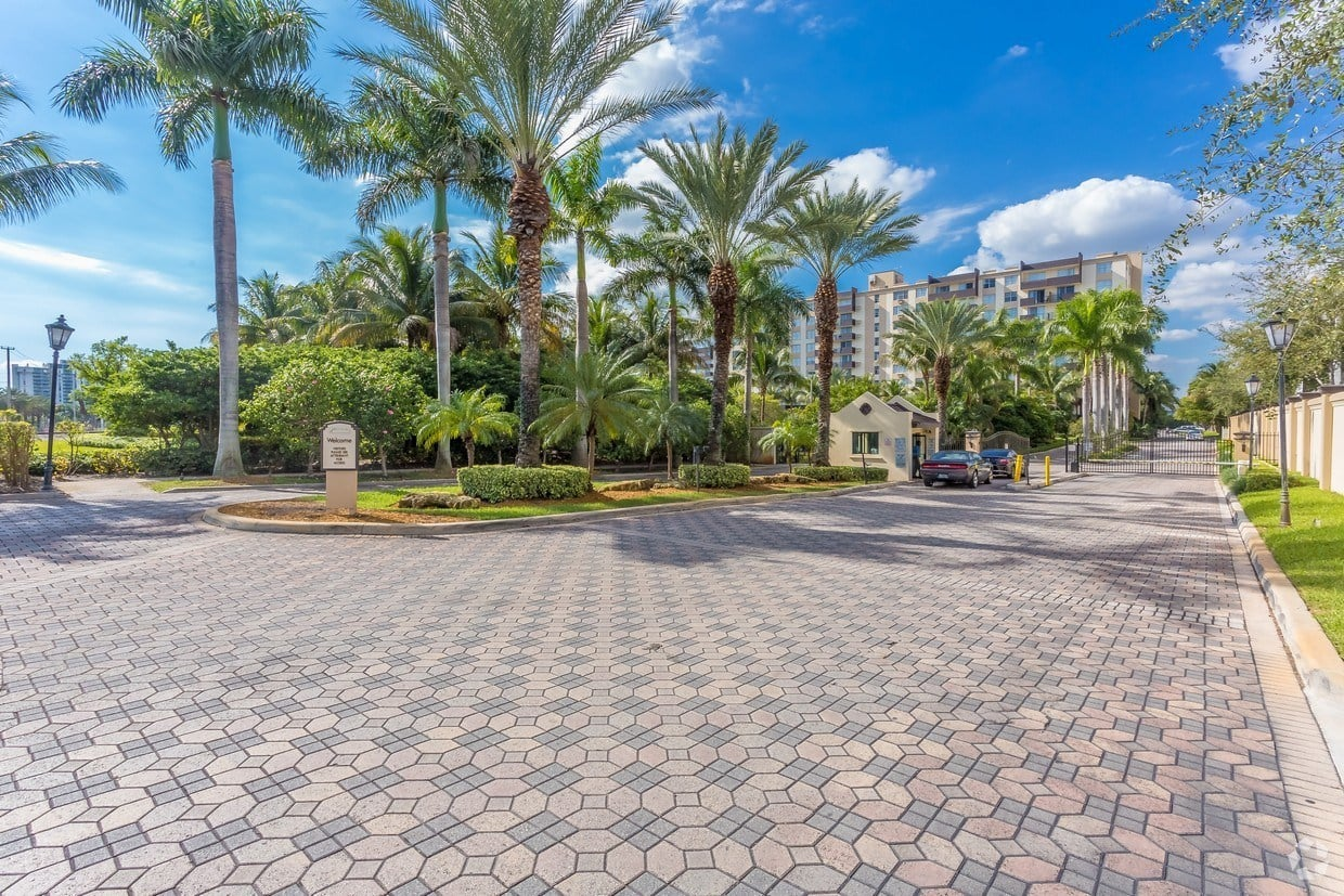 Beautiful driveway to our gated community at Aliro Apartments in North Miami, FL