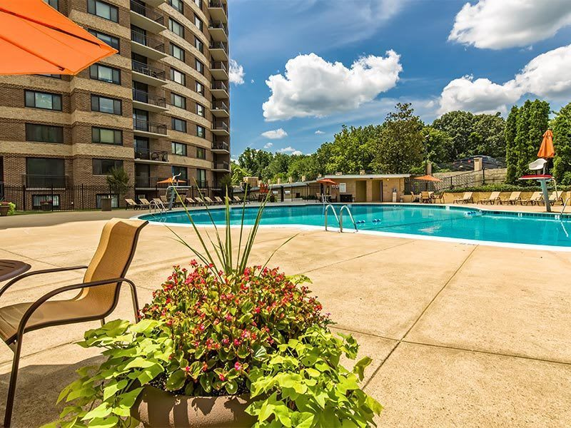 A pool is just one of the amenities offered at The Warwick Apartments