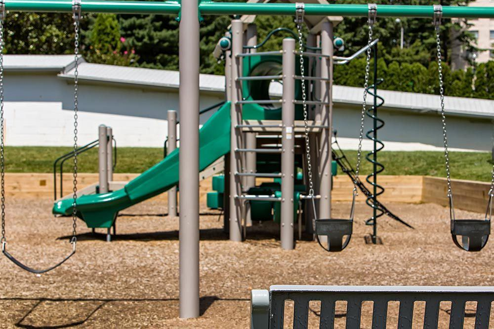 Children's playground at The Warwick Apartments