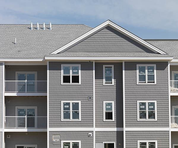 Building Exterior With Private Balconies at The Elm at Island Creek Village in Duxbury