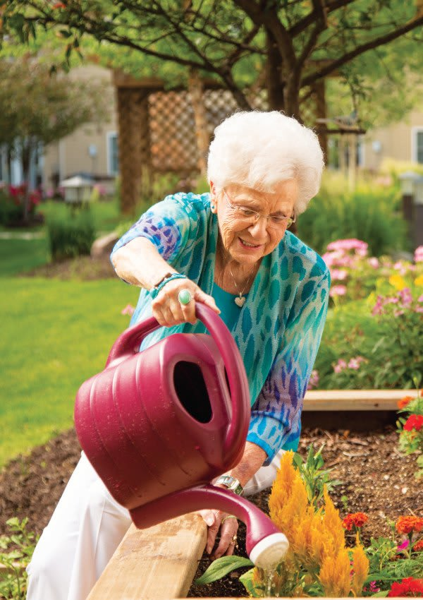 Woman gardening at Omaha Communities in Omaha, Nebraska