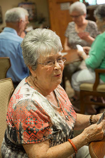 Happy senior woman enjoying activities at Orchard Pointe at Terrazza