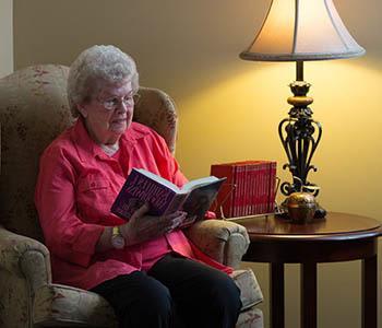Woman reading at Omaha Communities in Omaha, Nebraska