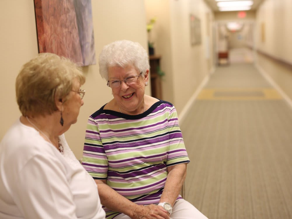 A resident and a care giver at The Heritage at Legacy
