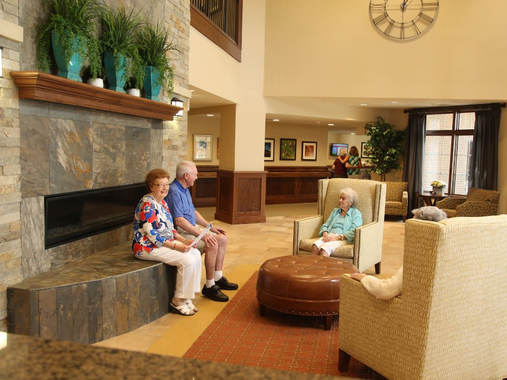 Some residents in the lobby at The Heritage at Legacy