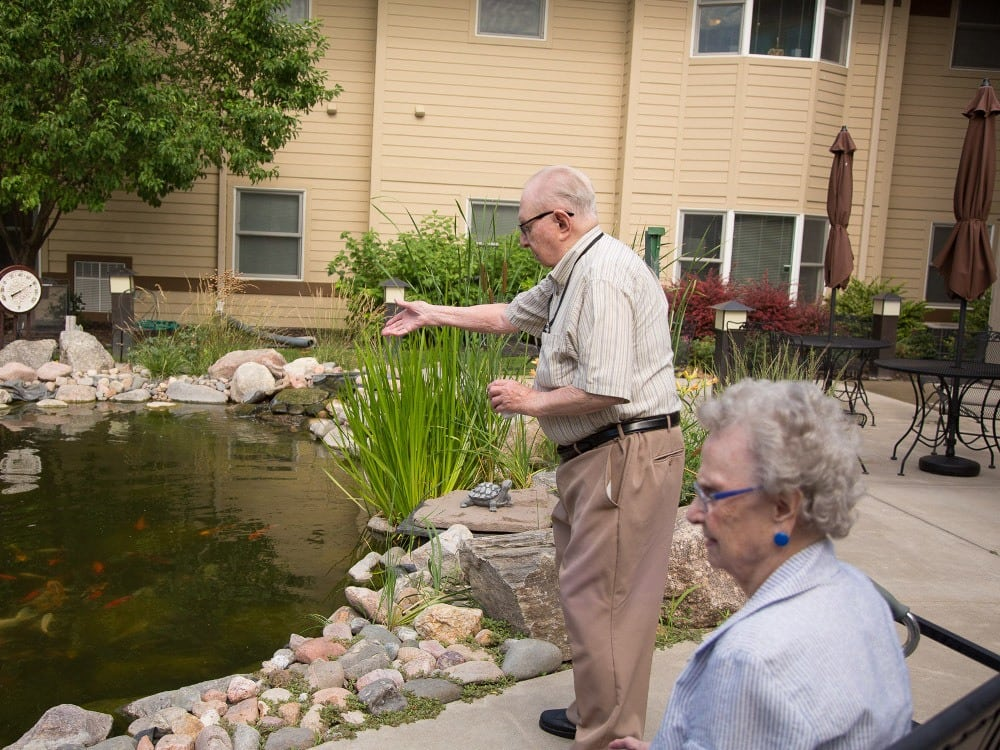A resident fishing in the pond at The Heritage at Meridian Gardens
