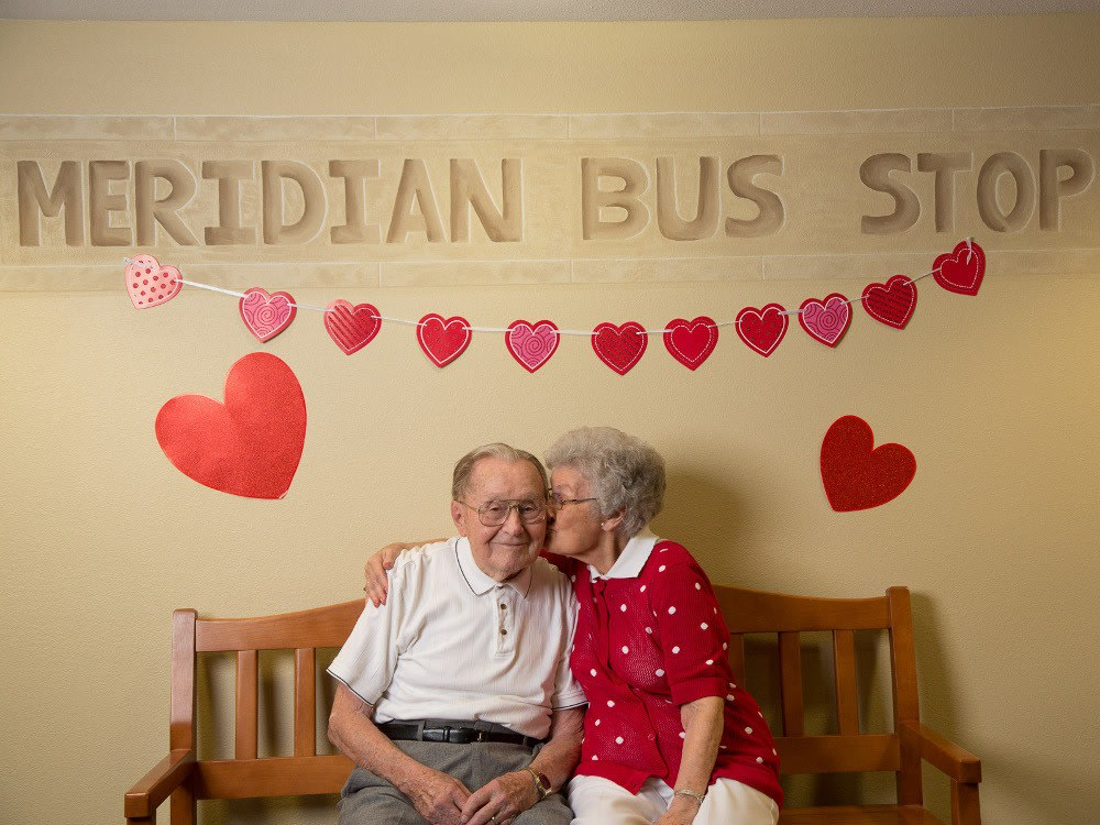 Two residents at The Heritage at Meridian Gardens spending time together
