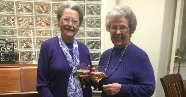 Friends having a drink at Alder Bay Assisted Living.