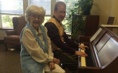 Staff and resident at Alder Bay Assisted Living.