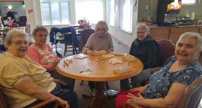 Staff and resident at Avalon Assisted Living Community.