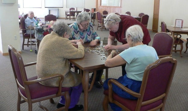 Put a puzzle together at Avalon Assisted Living Community.