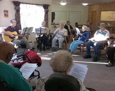 Resident singing at Avalon Assisted Living Community.