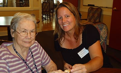 Staff and resident at Flower Mound Assisted Living.