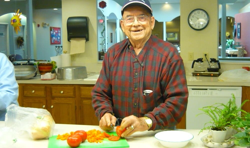 Community cooking at Garden Square Assisted Living of Casper