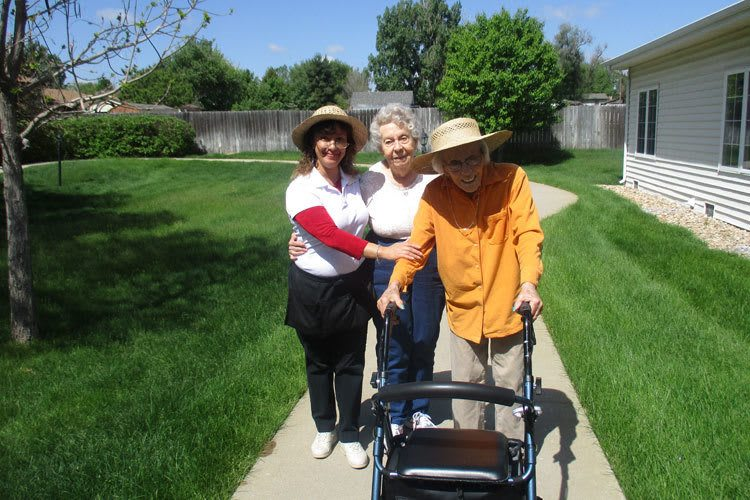 Taking a walk at Garden Square of Greeley Assisted Living and Memory Care
