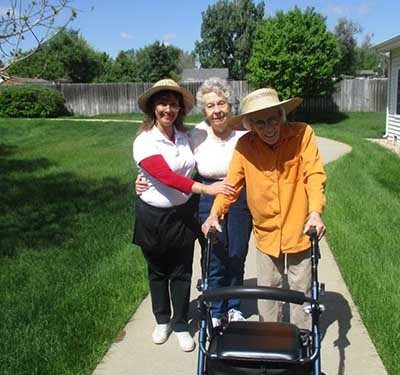 Resident walking at Garden Square of Greeley Assisted Living and Memory Care.