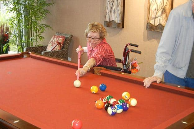 Playing pool at The Vistas Assisted Living and Memory Care