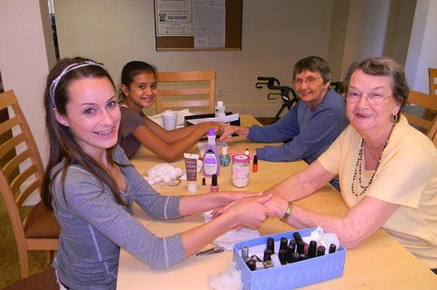 Getting nails done at The Vistas Assisted Living and Memory Care