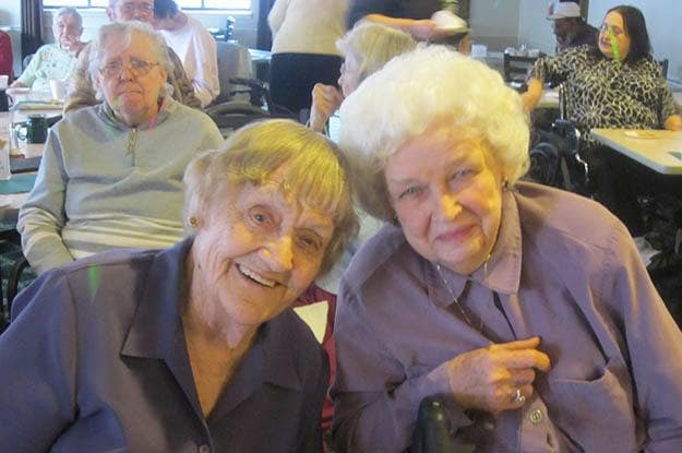 Two smiling residents at Wood Ridge Assisted Living