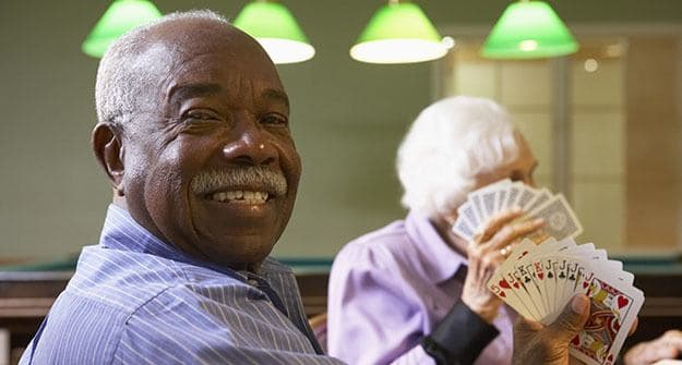 Playing cards at Wood Ridge Assisted Living