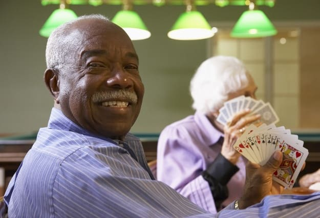 Resident playing poker at Brentwood at La Porte
