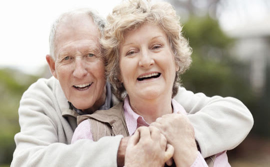 Senior couple embracing and smiling