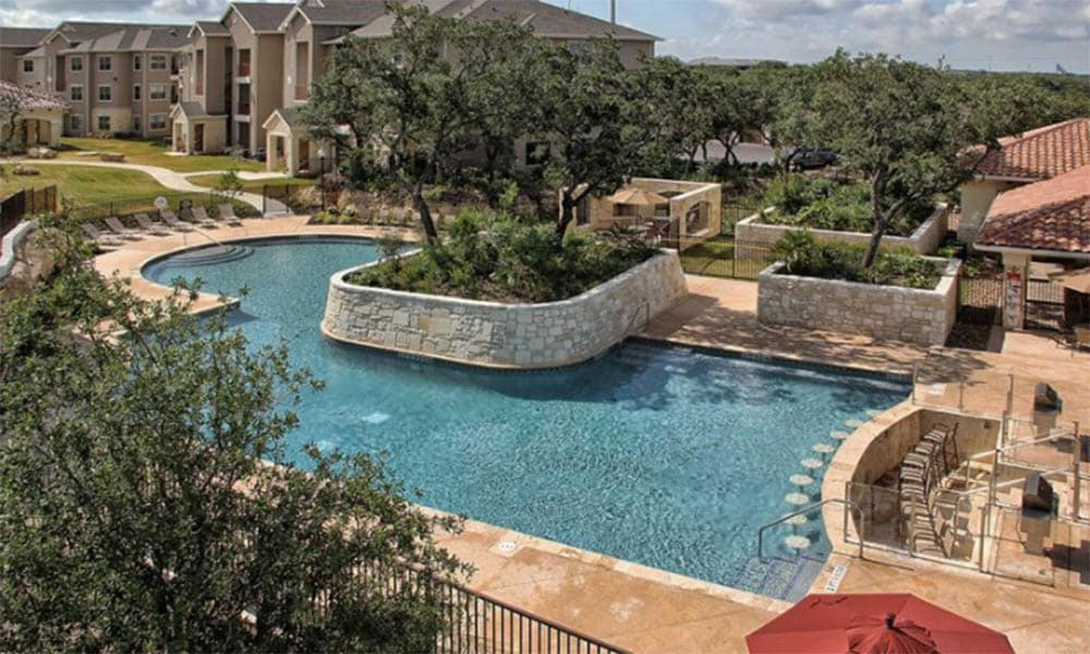 Aerial view of the pool at Pecan Springs Apartments