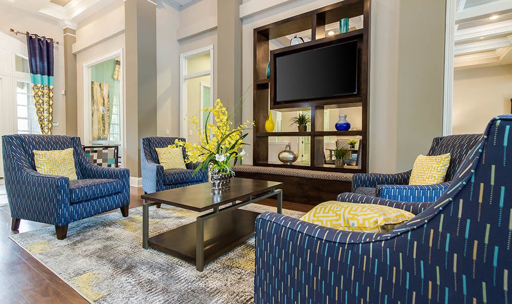 Clubhouse Seating Area With Tv at The Preserve at Tampa Palms in Tampa, FL
