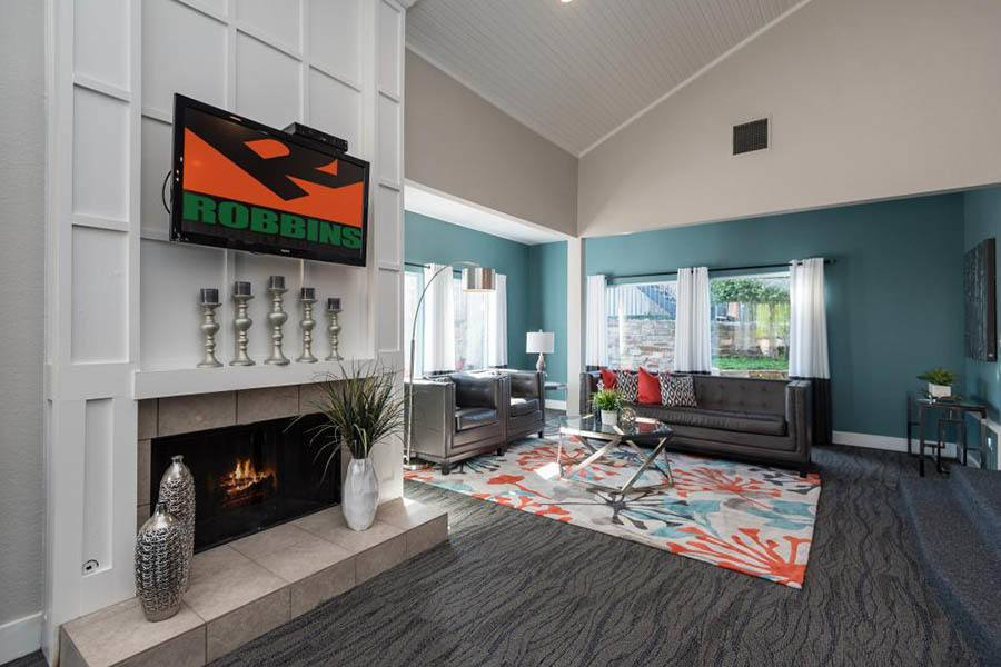 Clubhouse Seating With Fireplace And Tv at The Carling on Frankford